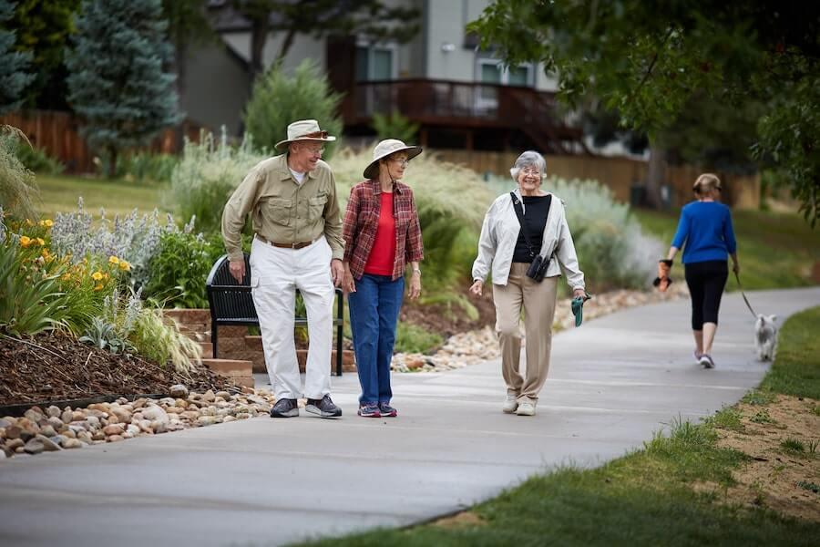 seniors walking on trail