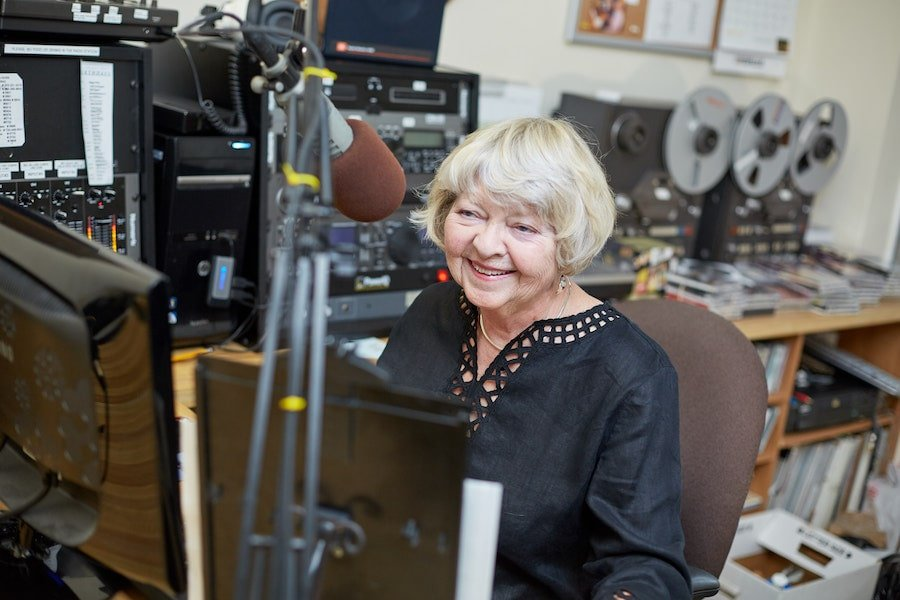 senior woman talking on radio