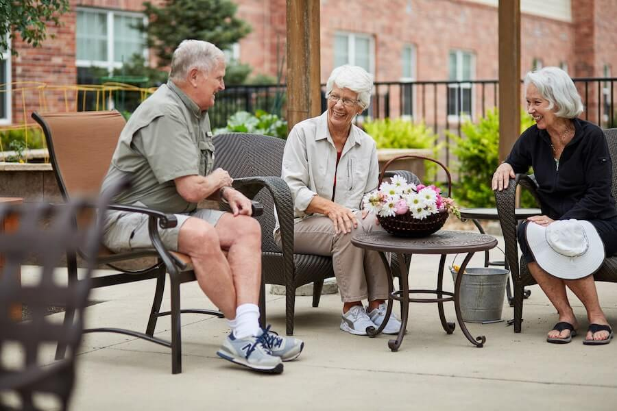 seniors sitting on a patio