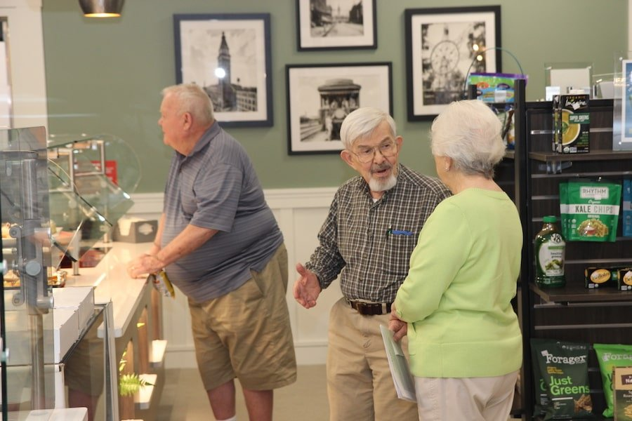 seniors gather in a cafe