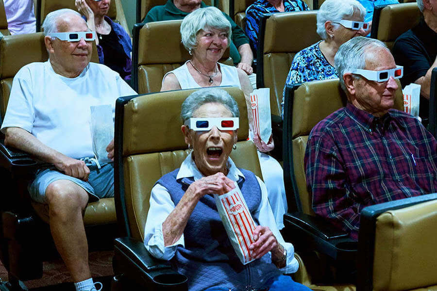 senior residents watching a movie in 3D