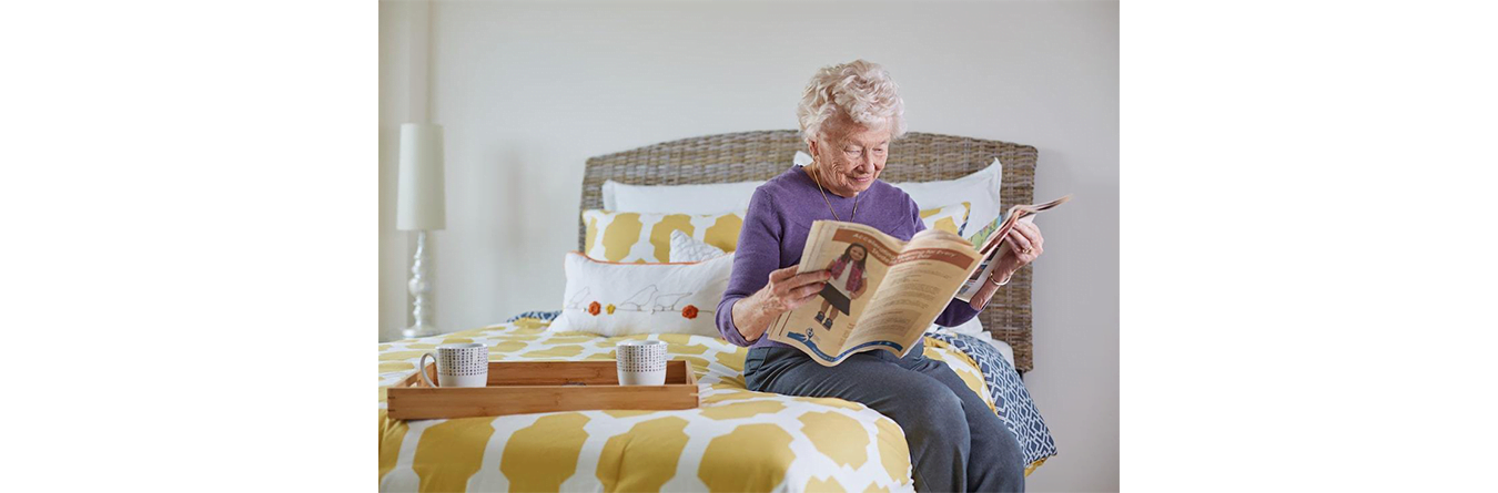 elder woman reading the paper