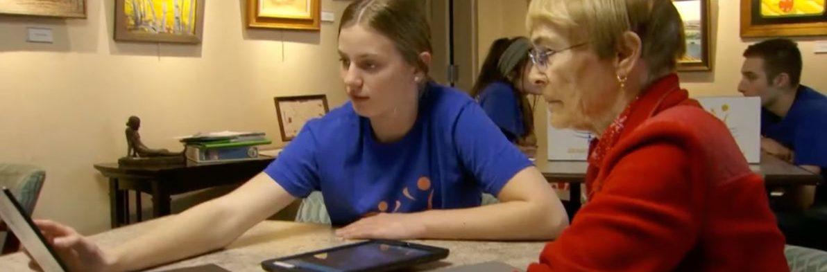 nurse helping elderly woman on computer